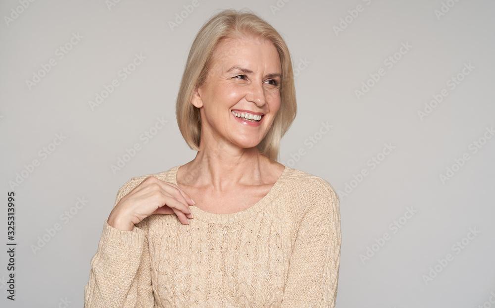 Fototapeta Close up portrait of beautiful older woman smiling. Isolated