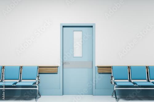 Canvastavla Row of blue chairs in empty hospital corridor