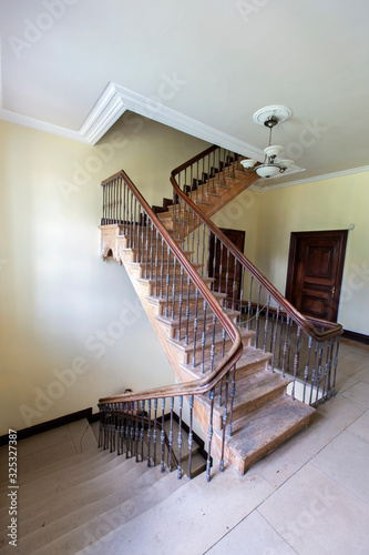 Photo Ancient staircase with iron balusters .
