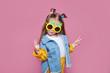 Leinwandbild Motiv Summer fashion concept. cheerful little girl in big pineapple sunglasses on pink background