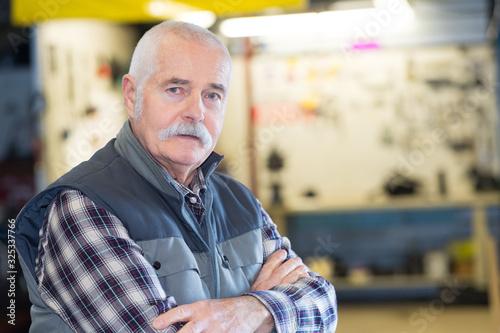 photo of senior man in his workshop