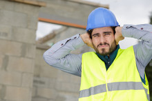 Construction Worker Covering E...