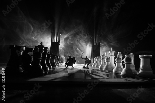 Cuadros en Lienzo Chess board game concept of business ideas and competition and strategy ideas Chess figures on a dark background with smoke and fog