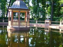 Gazebo On The Pond With A Bridge