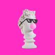 canvas print picture - Statue on a pink background. Gypsum statue of Apollo head. Man. Creative. Plaster statue of Apollo head in pixel glasses. Minimal concept art.