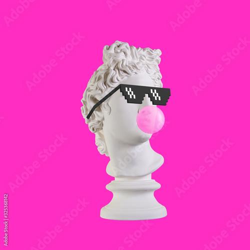 Valokuva Statue on a pink background