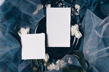 Wedding Invitation Mockup With Old Black Plate, Roses, Papers On Silk Blue Background. Top View, Flat Lay. Wedding Stationary. Perfect For Presentation Of Your Invitation, Menu, Greeting Cards