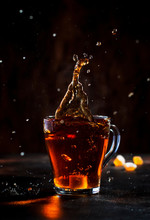 Splash In Glass Cup Of Black T...