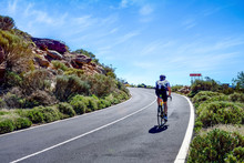 Cyclist On The Roads Crossing The Beautiful Desert Landscape On The Island Of Tenerife