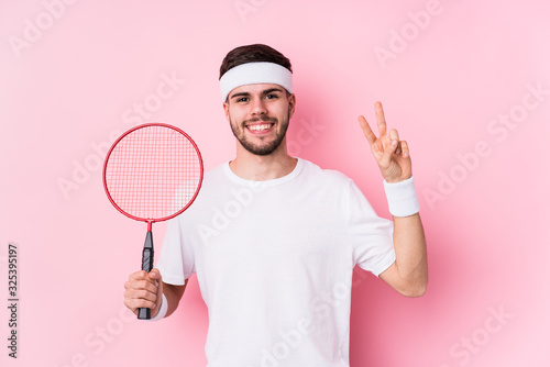 Young caucasian man playing badminton isolated showing number two with fingers Wallpaper Mural