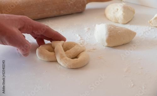 Obraz na plátně homemade pretzel preparation on white table