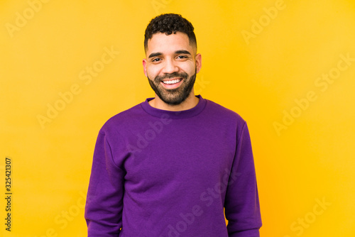 Young mixed race arabic man isolated happy, smiling and cheerful. Fototapete