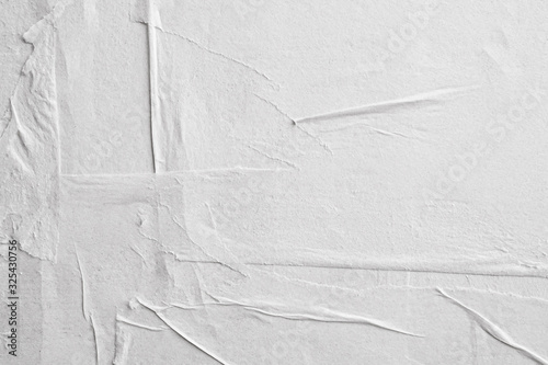 Fototapeta Blank white crumpled and creased paper poster texture background