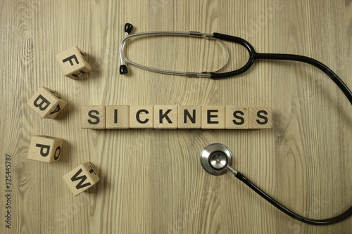 Valokuva Word sickness from wooden blocks with stethoscope