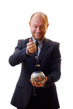 Businessman, Man In Black Suit And Tie Holds A Piggy Bank With Coins, The Cash Is Its Saving And Accumulation. Money Save In A Glass Vase.