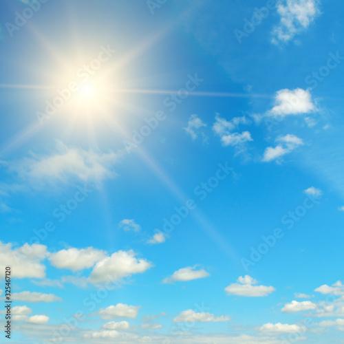 Fotografiet Bright midday sun in the blue sky.