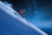Skier With A Backpack Rides Fr...