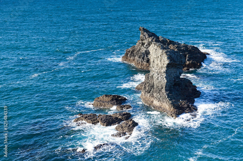 The rocks and cliffs in the ocean of the famous island Belle Ile en Mer in Franc Wallpaper Mural