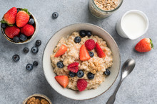 Bowl Of Oatmeal Porridge With Summer Berries. Top View. Clean Eating, Dieting, Weight Loss Concept