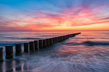 Fototapeta Optyczne powiększenie Baltic sea seascape at sunset, Poland, wooden breakwater and waves