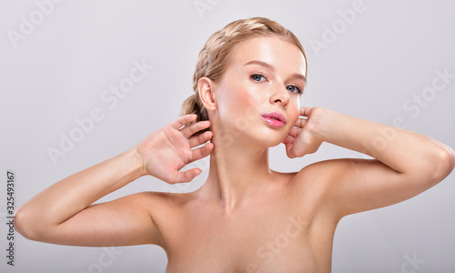 Beautiful young woman holding her arms up and showing clean underarms Wallpaper Mural