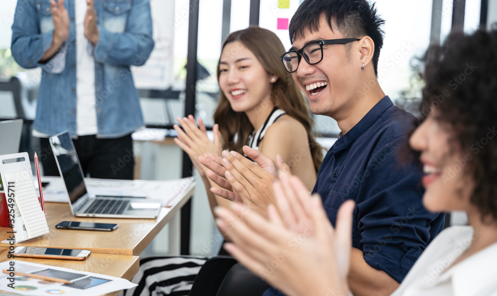 Fototapeta Happy Asian business clapping hands after business meeting successful in modern office