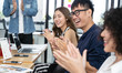 Happy Asian business clapping hands after business meeting successful in modern office