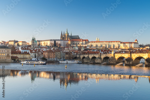 Obraz Panorama of winter Prague with reflection in the Vltava river of the Cathedral of St. Witt, Mala Strana, Charles Bridge at sunset - fototapety do salonu