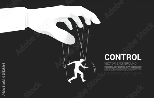 Photo Puppet Master controlling Silhouette of businessman