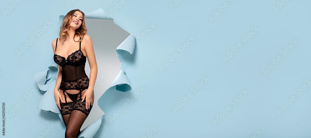 Fototapeta Lingerie model posing in studio.