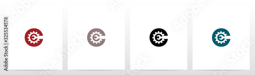 Obraz na plátne Wrench And Gears On Letter Logo Design C