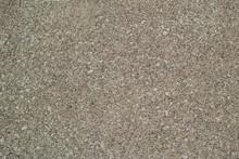 砂色でザラザラした細かい砂利が浮き出たコンクリート舗装の表面
