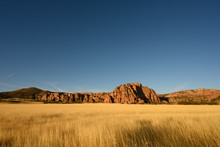 Dry Grassy Field And Red Rocks...