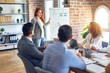 Group of business workers working together in a meeting. One of them making presentation to colleagues at the office