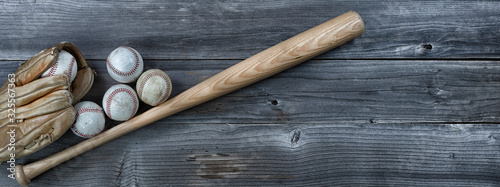 Photographie Used baseball equipment on vintage wooden background