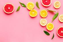 Citrus Slices Frame - Lemons, Grapefruits, Leaves - On Pink Background Top-down Copy Space