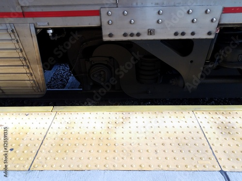 yellow tactile bumps and train on track