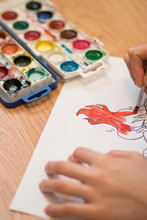 Girl Paints A Coloring Book Fo...