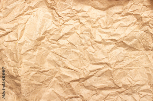 Crumpled brown craft paper. Texture, banner. Can be used as background. Top view, flat lay