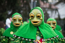Portrait Of People With Carnival Mask Of Frogs Parading In The Street