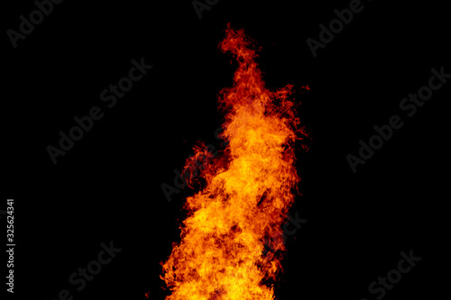 Yellow red and orange fire flames blazing fiery burning isolated on a black back Canvas-taulu