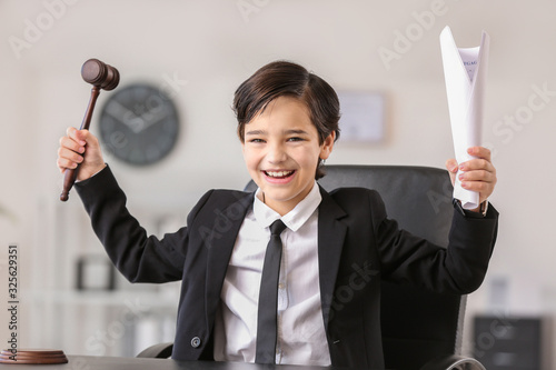 Happy little lawyer with judge gavel and document in office Canvas Print