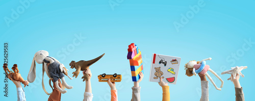 Children holding toys, concept of the childhood Wallpaper Mural