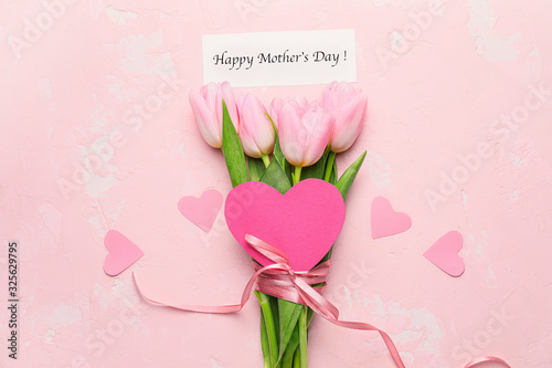 Obraz Beautiful flowers and card for Mother's Day on color background - fototapety do salonu