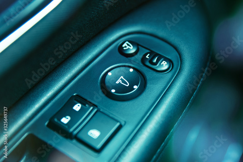 Photo Close-up to mirror adjustent panel in car