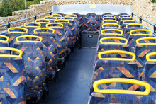 Passenger Seats On The Top Deck Of A Double Decker Bus