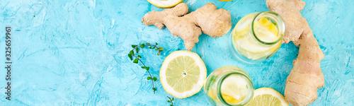 Fototapeta Banner of Detox water in bottles with ingredients, ginger, lemon, mint