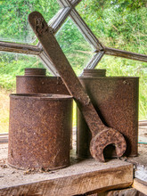 Old Rusty  Cans And Wrench By ...