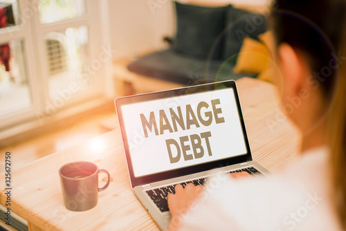 Photo Writing note showing Manage Debt