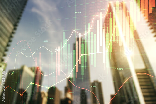 Fotografía Multi exposure of abstract financial chart on office buildings background, resea